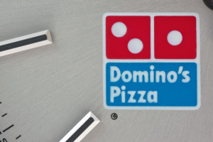 rolex dominos pizza logo